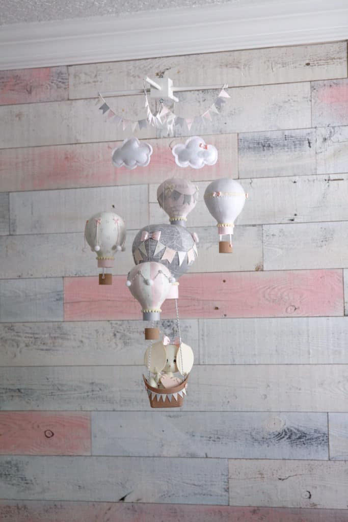 Custom Bunny and Hot Air Balloon Mobile in a  Pink & White Rustic Chic Baby Nursery- complete with a custom white and pink distressed wood wall