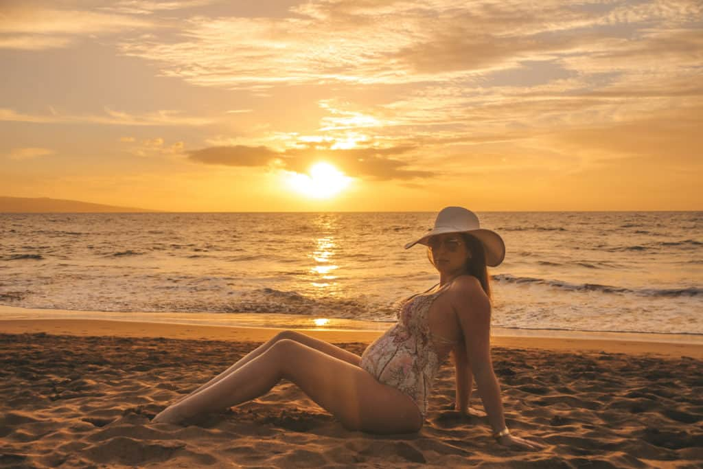 Enjoying a beautiful sunset in Maui during my Babymoon in Hawaii