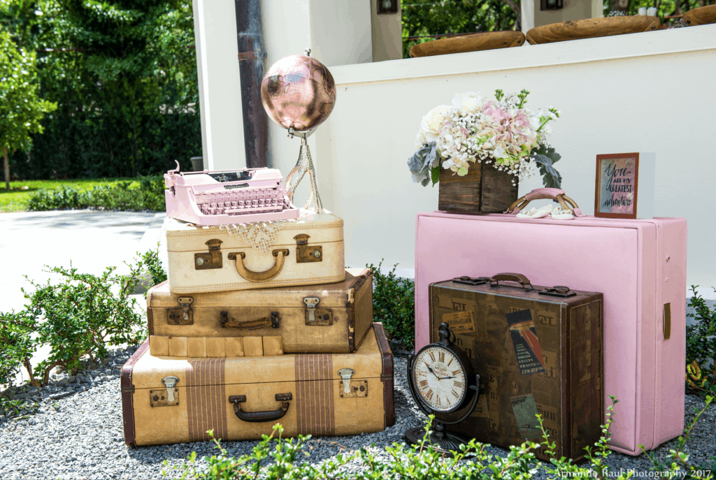 Some of the vintage travel details for my You Are Our Greatest Adventure baby shower for my little girl - decorated with antique luggages, globe, typewriter and flowers