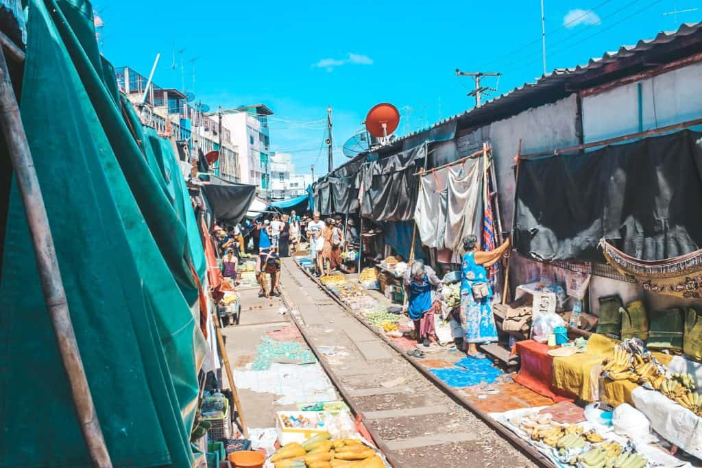The railway market in Thailand... the train goes right past all the vendors. When the train is coming they pull back their canopies to make space for the train. Tour of the Railway Market and Floating Market from Bangkok, Thailand. #bangkok #thailand #railwaymarket #floatingmarket