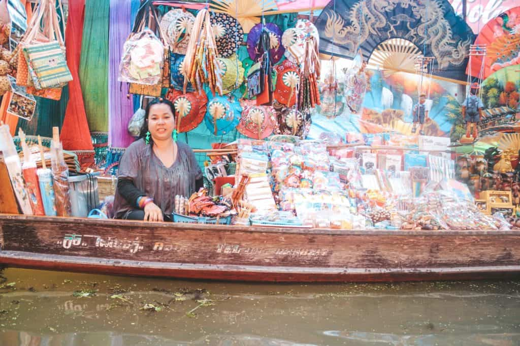 One of the vendors at the floating market in Thailand... an entire market on the waterway and the vendors are each on their little boats. Tour of the Railway Market and Floating Market from Bangkok, Thailand. #bangkok #thailand #railwaymarket #floatingmarket