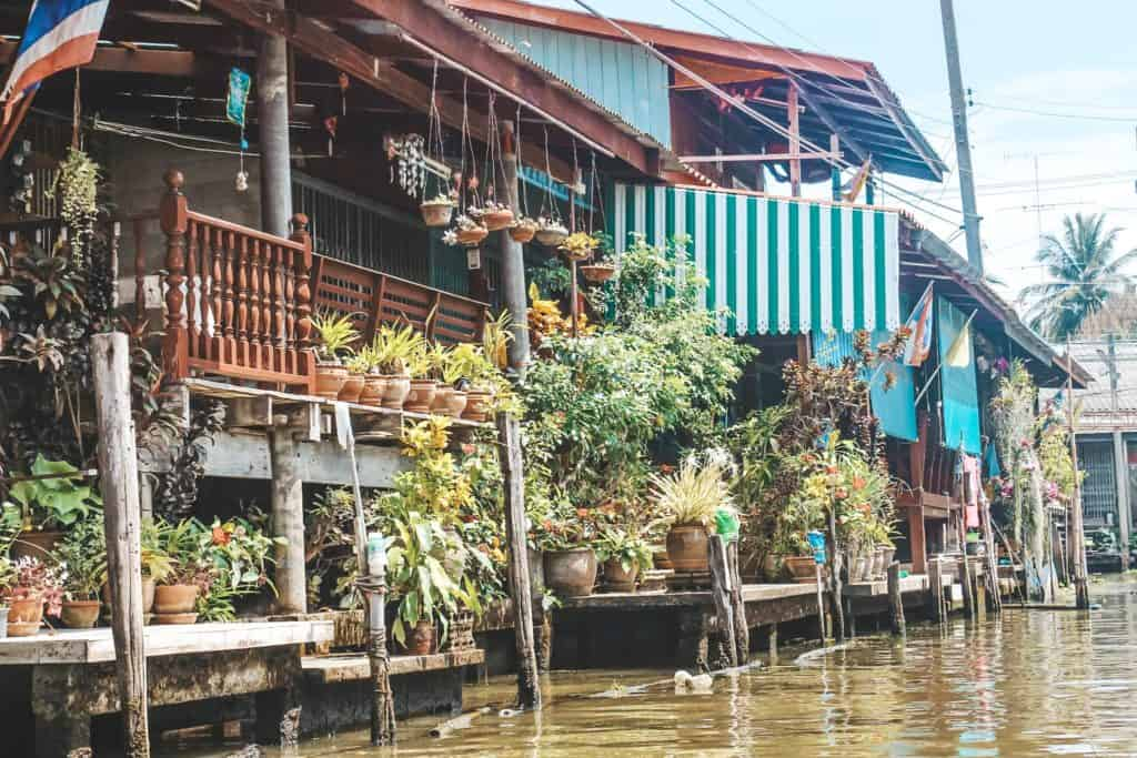 Some of the houses on the floating market in Thailand... an entire market on the waterway and the vendors are each on their little boats. Tour of the Railway Market and Floating Market from Bangkok, Thailand. #bangkok #thailand #railwaymarket #floatingmarket