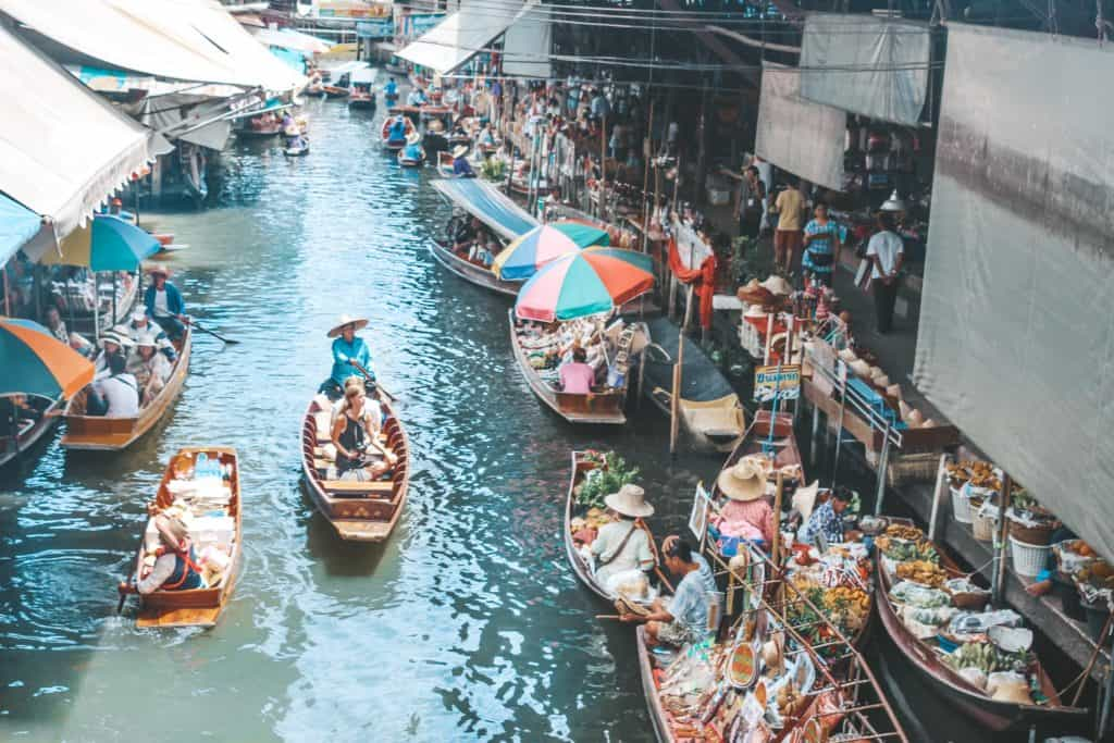 The floating market in Thailand is an entire market on the waterway and the vendors are each on their little boats. Tour of the Railway Market and Floating Market from Bangkok, Thailand. #bangkok #thailand #railwaymarket #floatingmarket