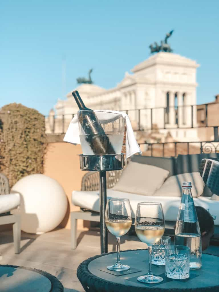 The rooftop bar at the Otivm Hotel in the city center of Rome, walking distance from most of the main sites. It's a budget friendly boutique hotel with great service and super spacious rooms - ours even had a king size bed. Rome | Italy | budget friendly boutique hotel | great service | spacious rooms | king size bed | rooftop bar overlooking the city | best hotel #rome #italy #italia #otivmhotel #besthotel #rooftopbar