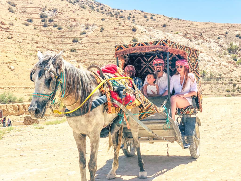 Horse and carriage ride to see the Treasury in Petra, Jordan. One of the ways to make it to the Treasury, while skipping the long hike. | Middle East | Best Vacation Destination | Petra | The Treasury | Dead Sea | Bedouin dinner | Amman