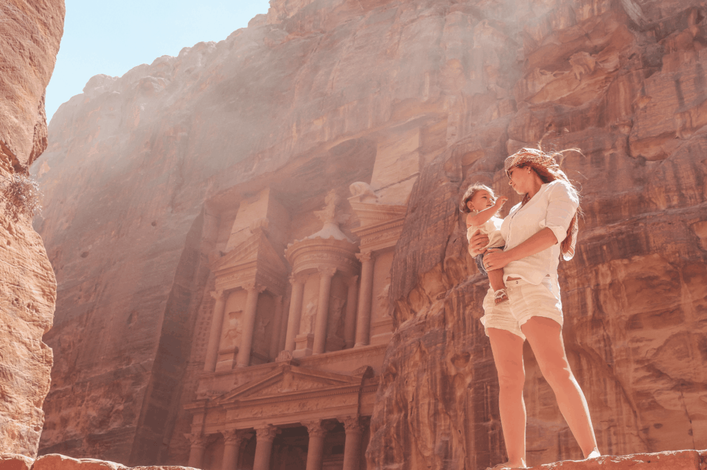 Petra is an area of Jordan not to be missed! The Treasury is an incredible structure carved out of sandstone rock that is even more magical in person. | Middle East | Best Vacation Destination | Petra | The Treasury | Dead Sea | Bedouin dinner | Amman