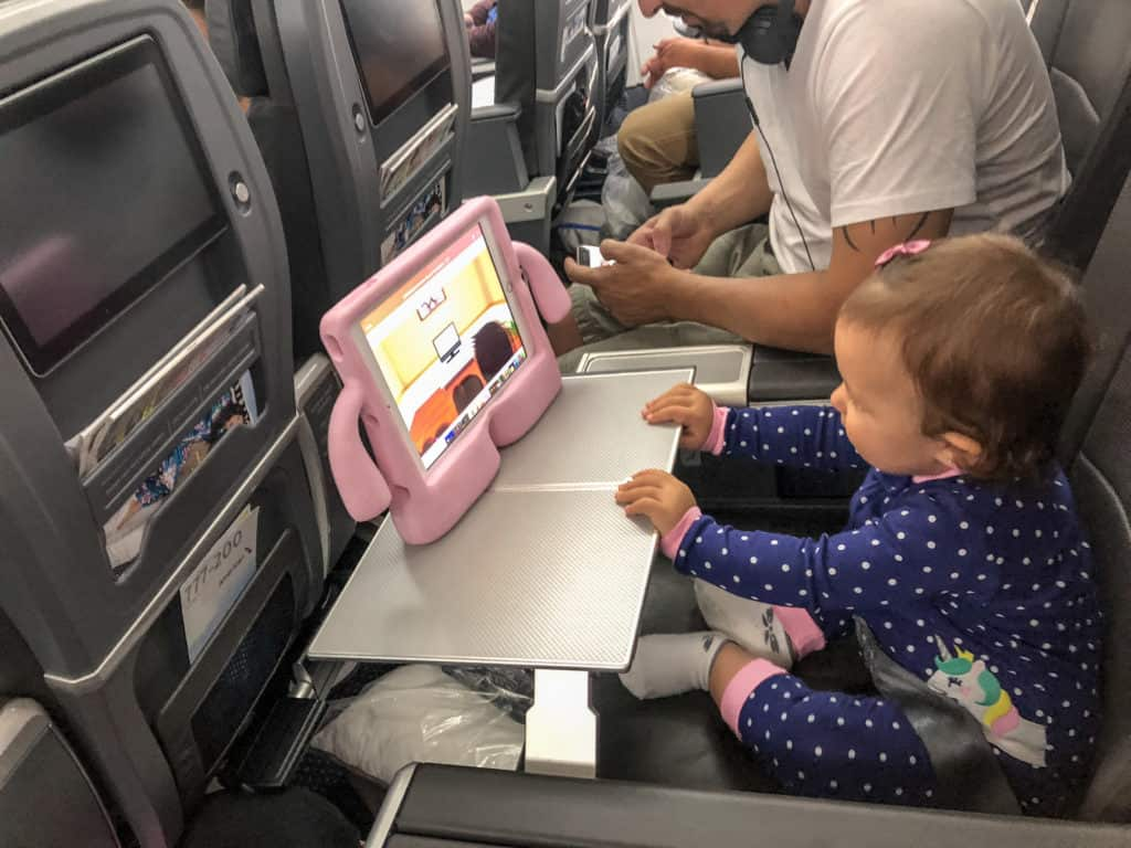Must Have for a child on a long flight - An iPad with a baby proof case and some downloaded shows and games to play.
