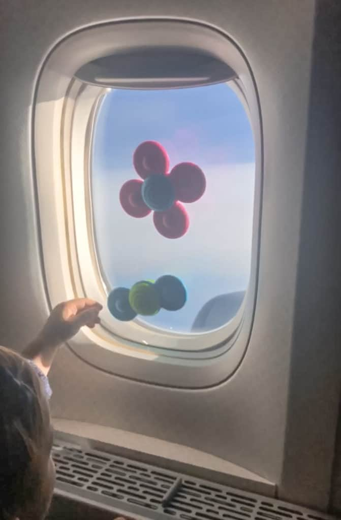 Kids Travel Must Have - suction toys for the airplane. These suction cup spinners go on the airplane window and keep my daughter busy for a long time. Great for a baby and even a bigger kid.