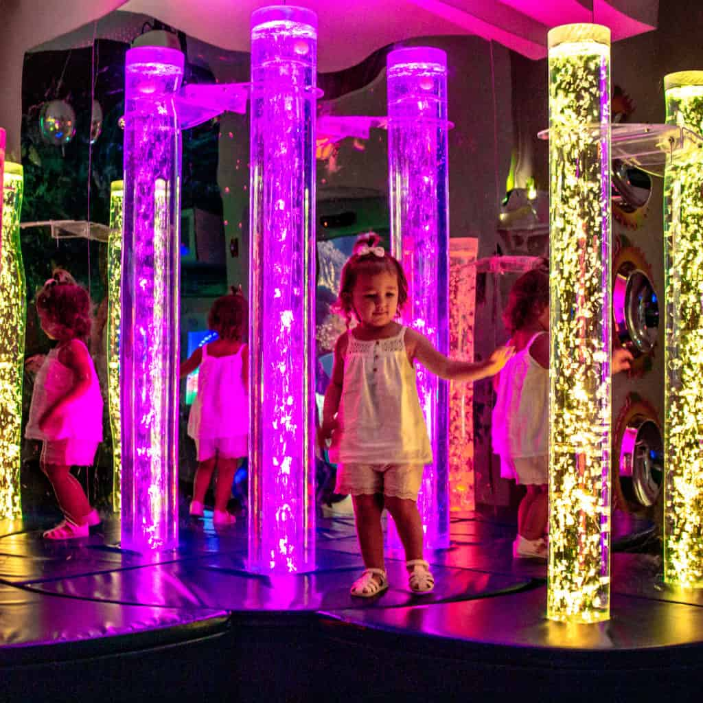 Inside the Miami Children's Museum - Multi-Sensory Room is a dark room filled with lights, bright colors and an interactive floor that are all constantly changing.