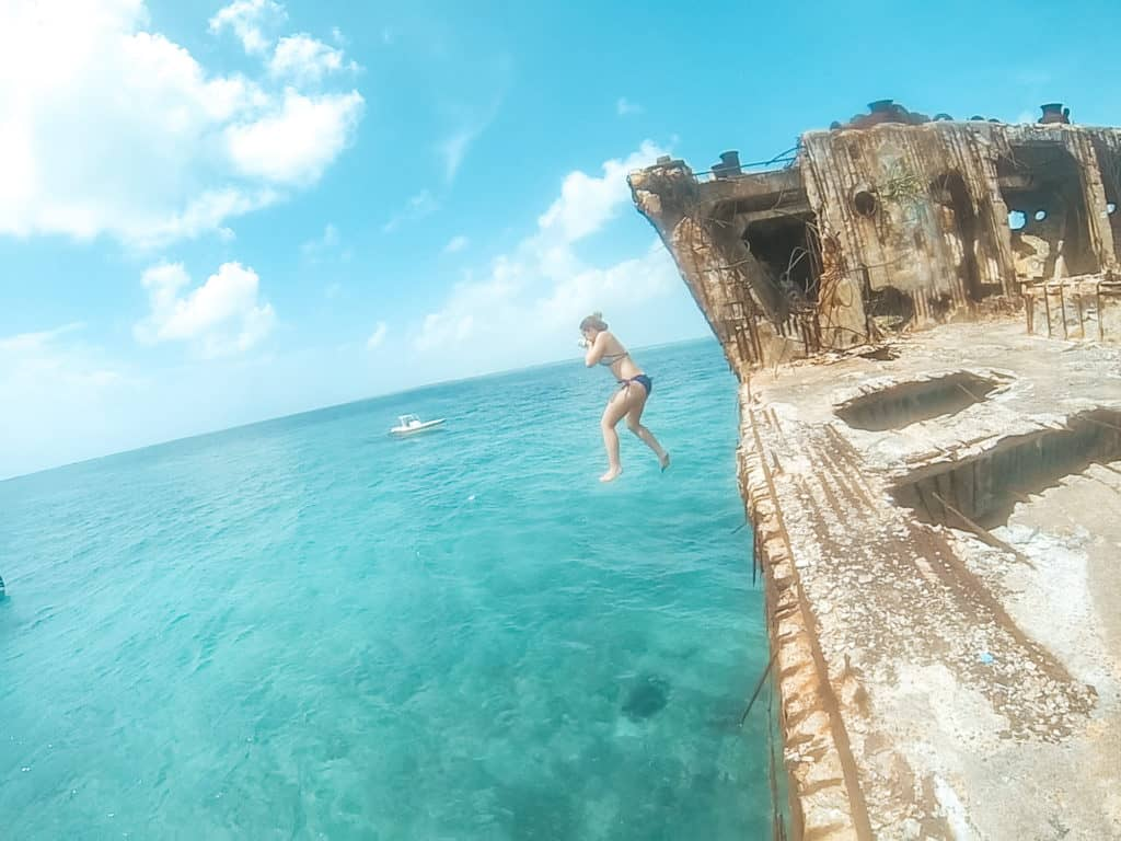 Jumping off the top of the SS Sapona, the shipwreck near Bimini, the Bahamas
