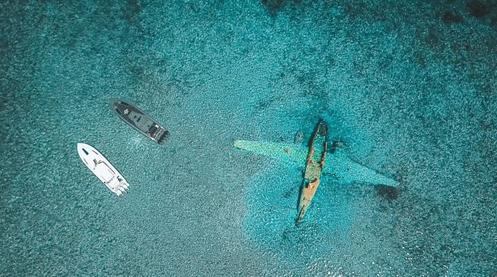 Sunken plane by Normans Cay, Exuma, Bahamas - best places to snorkel in the Exumas - sunken drug cartel plane