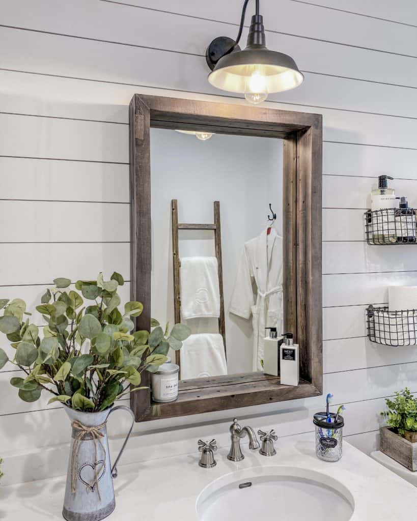 Farmhouse Chic bathroom renovation - Eucalyptus plant in a galvanized milk jug, Brushed Nickel vintage style faucets, mason jar bathroom accessories & hand lotions and candles to add the farmhouse chic look to our bathroom makeover