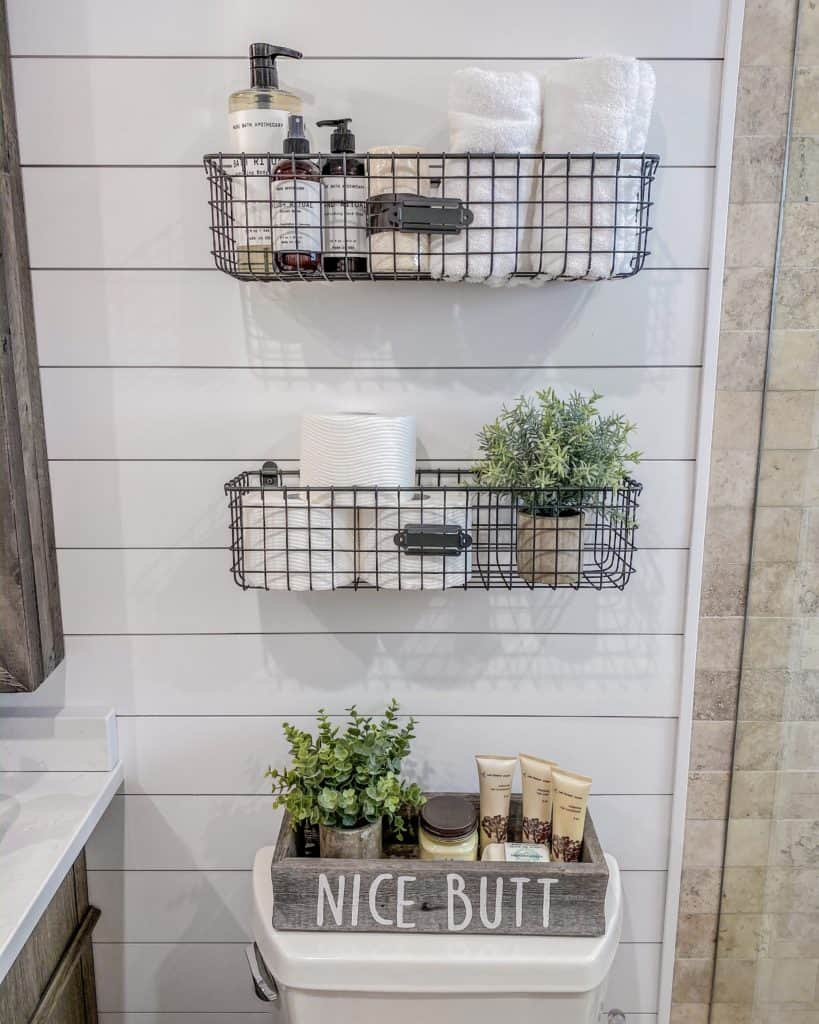 Baskets & Nice Butt Tray add a farmhouse chic touch to our bathroom renovation