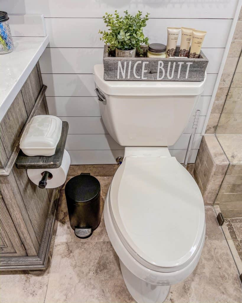Industrial looking toilet paper holder with a shelf & the perfect tiny garbage can for our Farmhouse Chic Bathroom Renovation