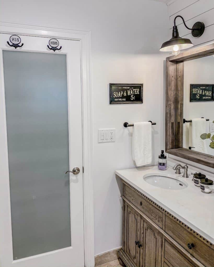 His & Hers Towel Hooks, Farmhouse Bathroom Sign & a simple towel bar to complete the bathroom makeover