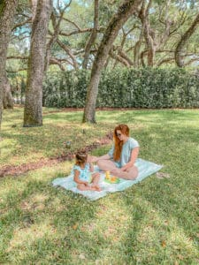 Quarantine Activities for Toddlers & Kids by The Traveling Red - Picnic Lunch under the trees