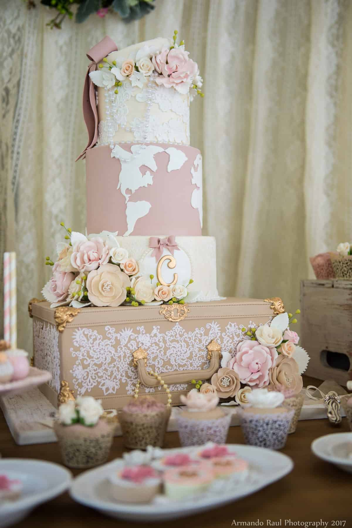 Girl Baby Shower Cake with Vintage Luggage, Lace, Pink, Flowers, Pearls, Bows & a World Map | Vintage Travel Theme Baby Shower | Baby Girl | You Are My Greatest Adventure | Lace, World Map, Flowers, Cameras, Vintage Decor | Cake, Sweets, Desserts, Lounge Seating Area, World Cuisine, Food Stations, Seating Arrangement | Home Baby Shower | Blush Pink, Beige, Gold, Champagne, White