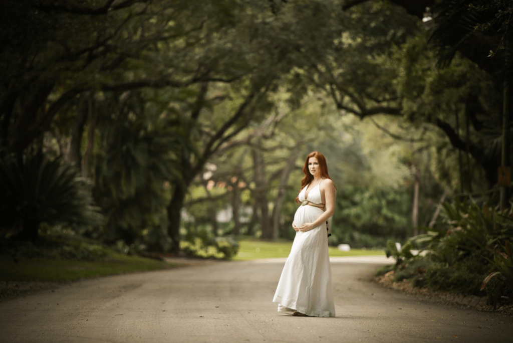 Home Maternity Shoot -  pregnant in a white dress out on the street in front of the house - beautiful trees