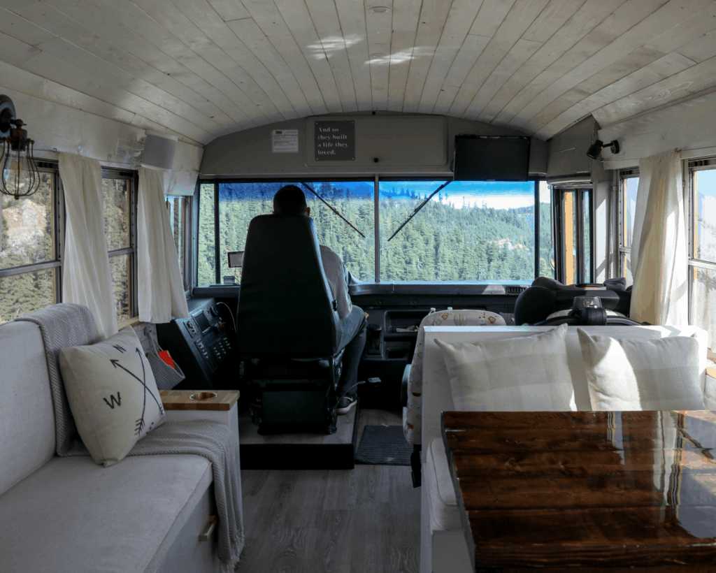 Driving our yellow school bus in Mount Rainier, Washington that was converted into a vacation home on wheels, known as a skoolie.