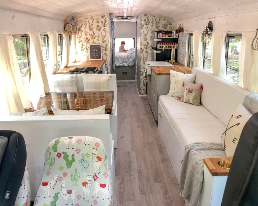 Inside a School Bus conversion. Yellow school bus, turned tiny home on wheels. Interior of the Skoolie, 2 cool 4 skool bus.
