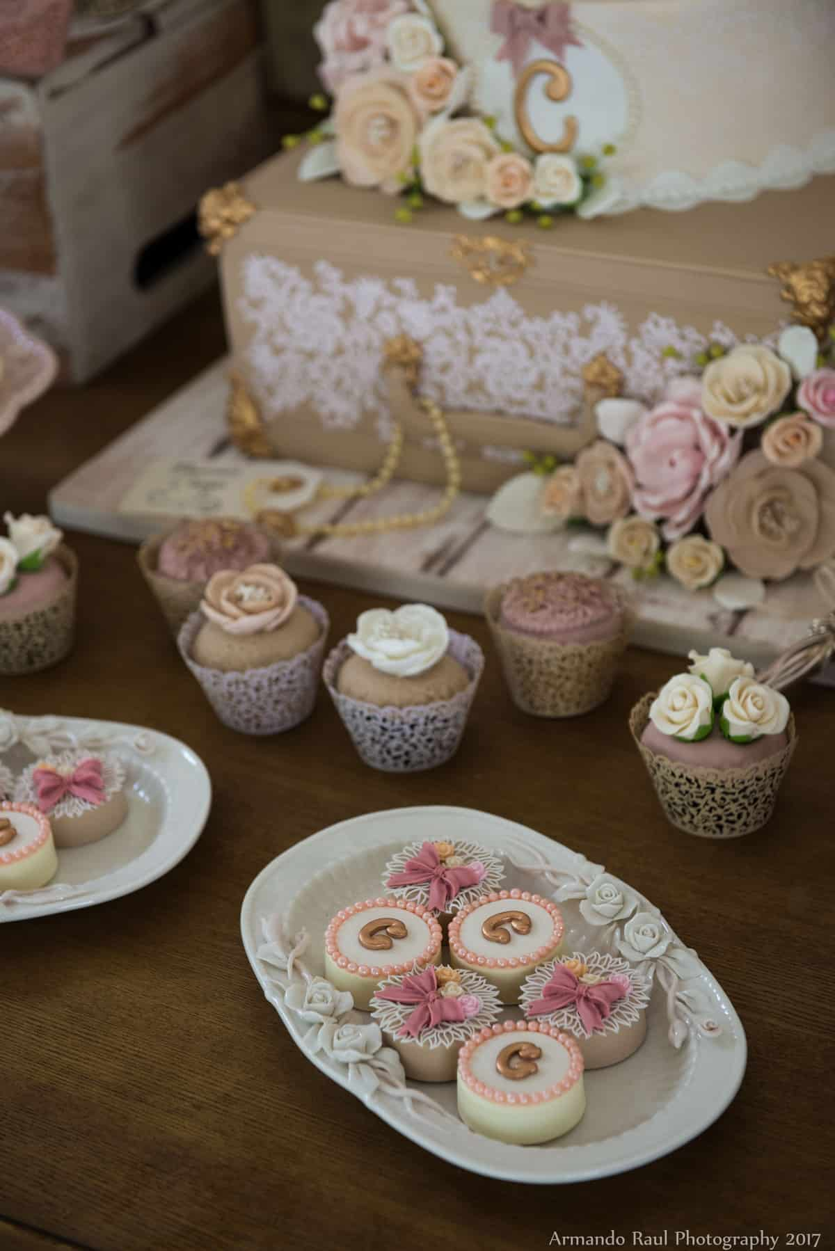 Cupcakes & Chocolate Covered Oreos on the Dessert Table | Girl Baby Shower Cake with Vintage Luggage, Lace, Pink, Flowers, Pearls, Bows & a World Map | Vintage Travel Theme Baby Shower | Baby Girl | You Are My Greatest Adventure | Lace, World Map, Flowers, Cameras, Vintage Decor | Cake, Sweets, Desserts, Lounge Seating Area, World Cuisine, Food Stations, Seating Arrangement | Home Baby Shower | Blush Pink, Beige, Gold, Champagne, White