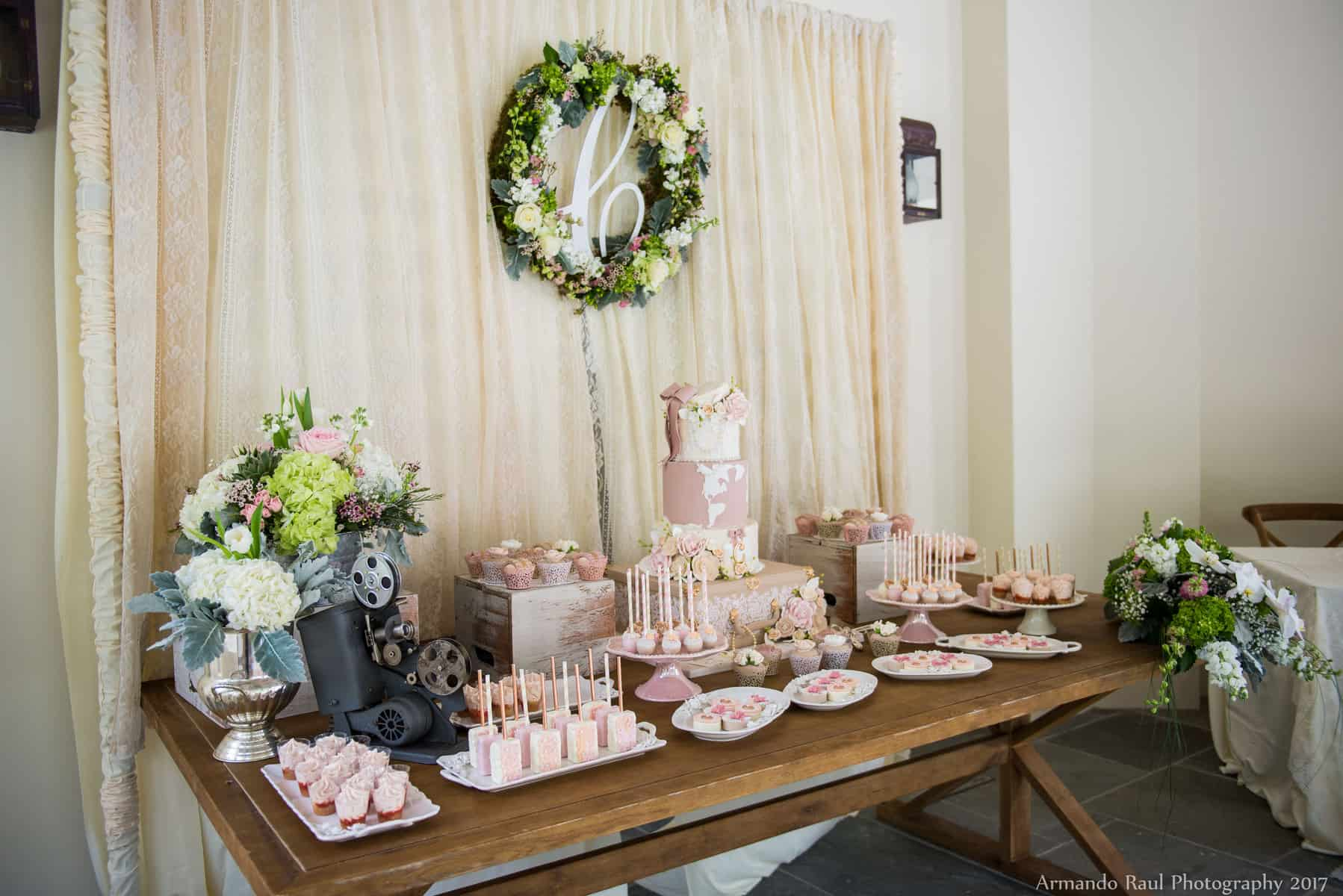 Vintage Travel Theme Baby Shower Dessert Table | Baby Girl | You Are My Greatest Adventure | Lace, World Map, Flowers, Cameras, Vintage Decor | Cake, Sweets, Desserts, Lounge Seating Area, World Cuisine, Food Stations, Seating Arrangement | Home Baby Shower | Blush Pink, Beige, Gold, Champagne, White