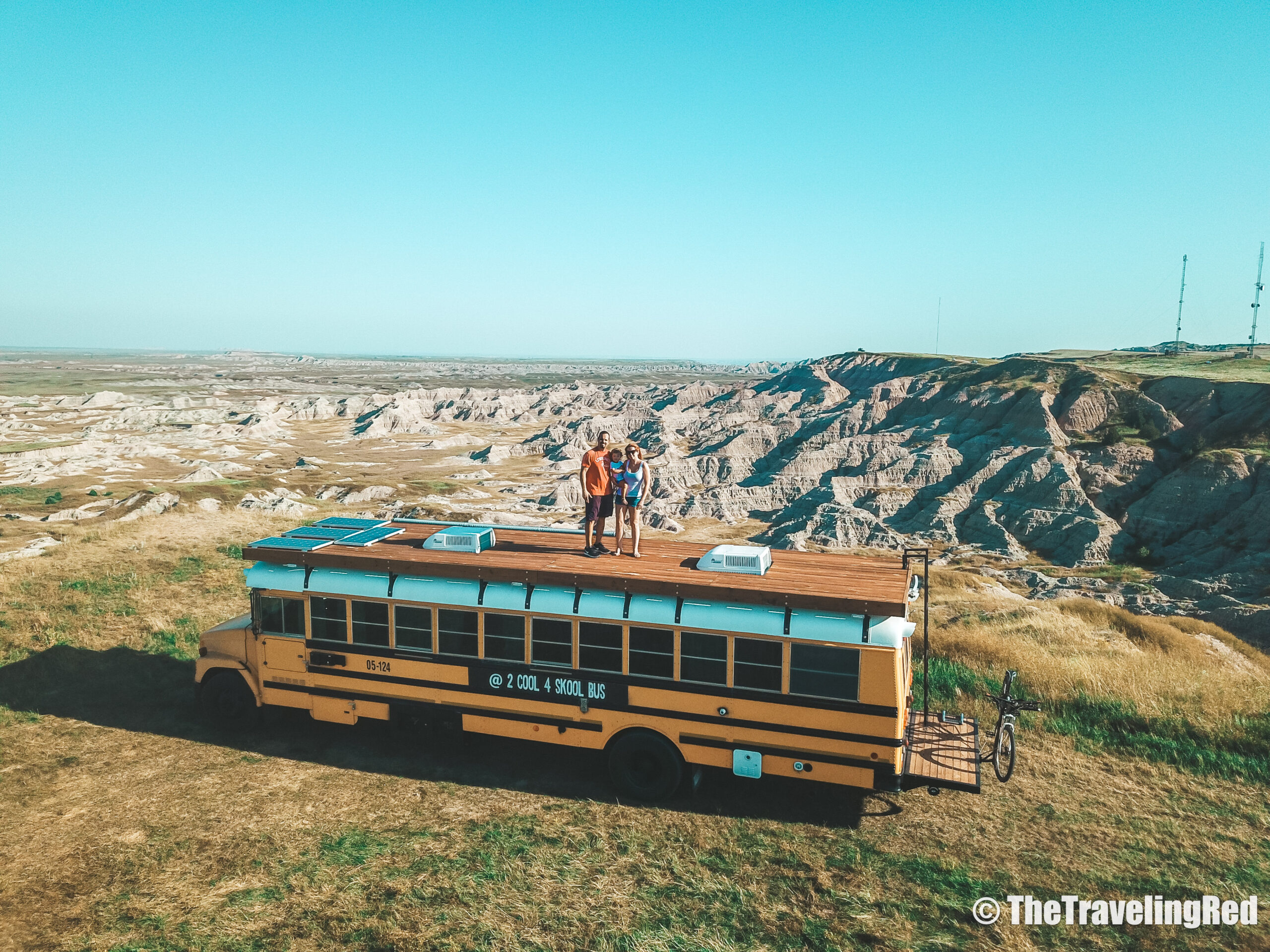 School Bus Conversion, 2 Cool 4 Skool Bus. On our roof deck in the Badlands. Full analysis of the cost of converting a yellow school bus into a vacation home on wheels. All of the details of our skoolie conversion. Our vacation home that took us on a road trip around the US to see some of the countries most beautiful places. #ConversionCost #SchoolBus #Skoolie #SchoolBusConversion