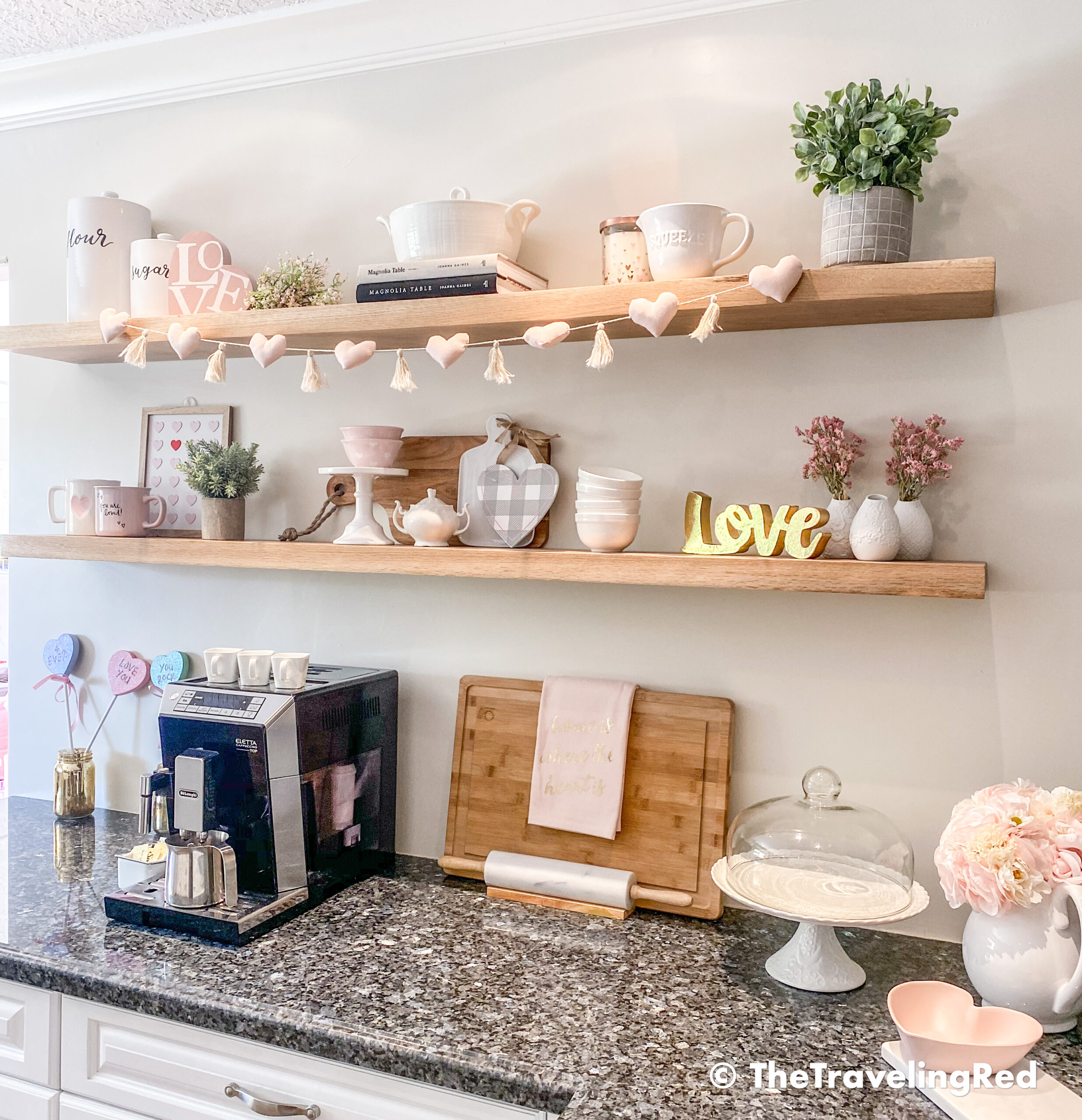 Valentine's Day Home Decor - Kitchen Shelves styling using soft pinks, garlands, artificial flowers, wood signs and some fun kitchen pieces - #valentinesday #valentinesdaydecor #homedecor #kitchenshelves #valentinesdayhomedecor