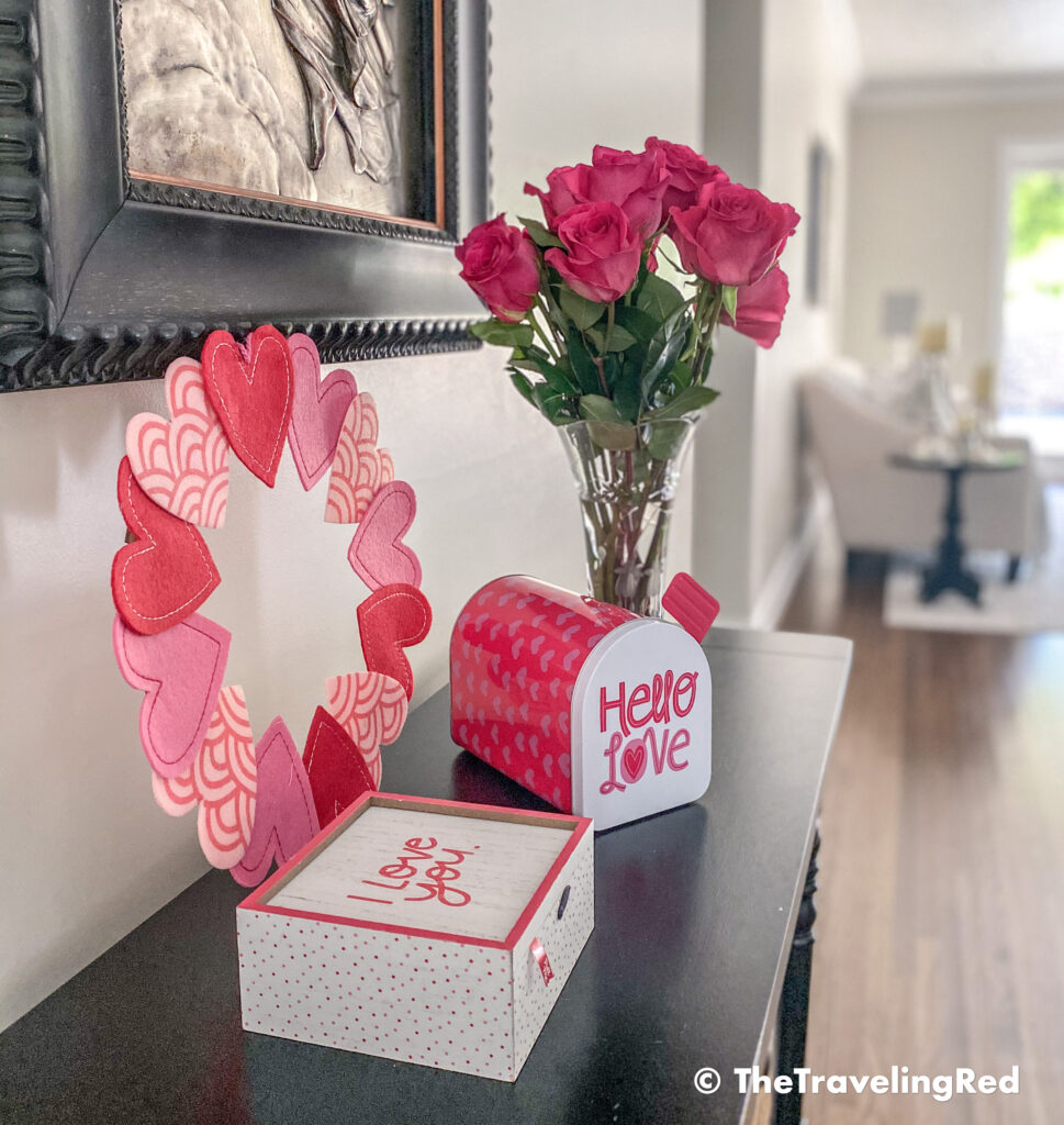 Valentine's Day Home Decor - Front entrance table with a simple wreath, mailbox, keepsake box and some fresh pink roses - #valentinesday #valentinesdaydecor #homedecor #tabledecor #valentinesdayhomedecor