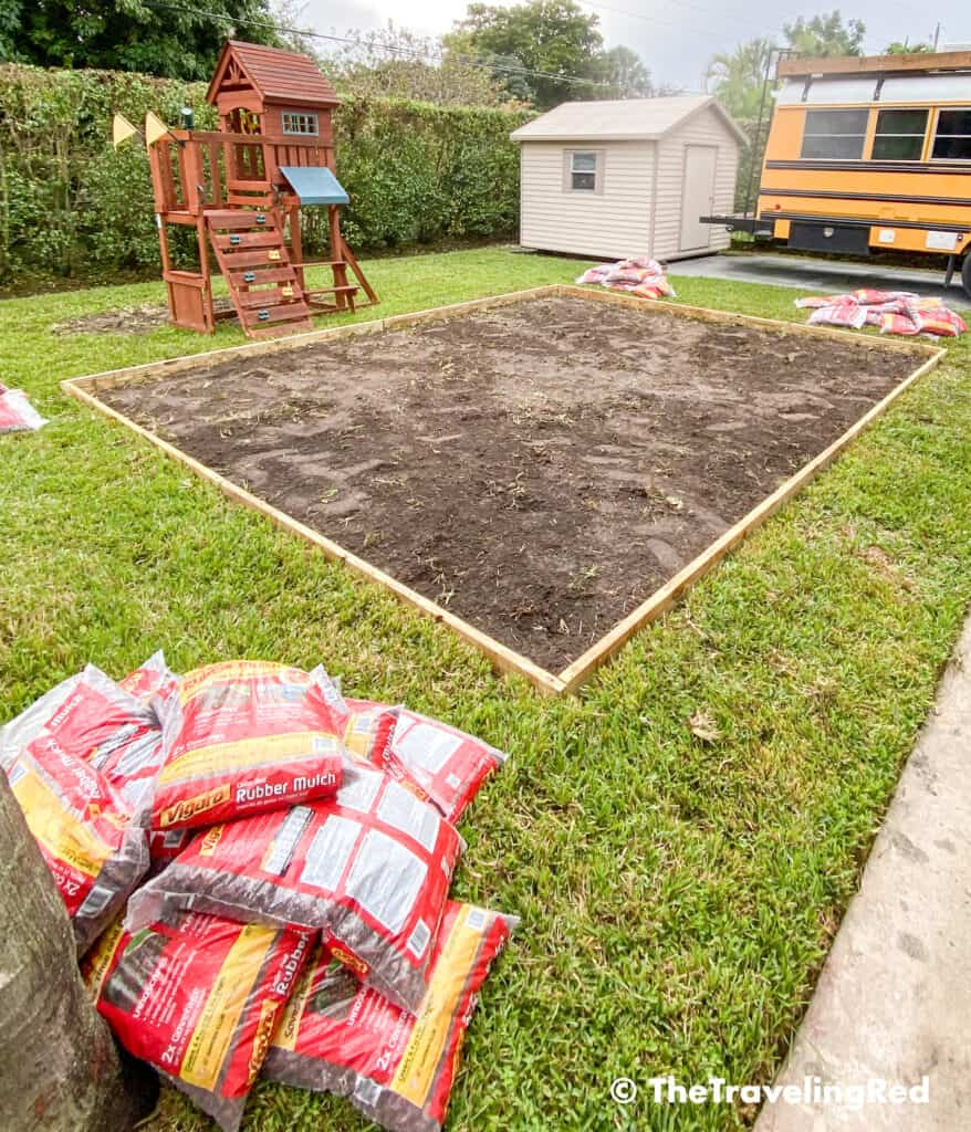 How to build a custom backyard playground with rubber mulch. Step 3 is to add a wood edge to enclose the area. This space will fit our swingset, playhouse, sandbox or any other outdoor toys you plan to include. Perfect little outdoor play space for your kids to enjoy playing outside.
