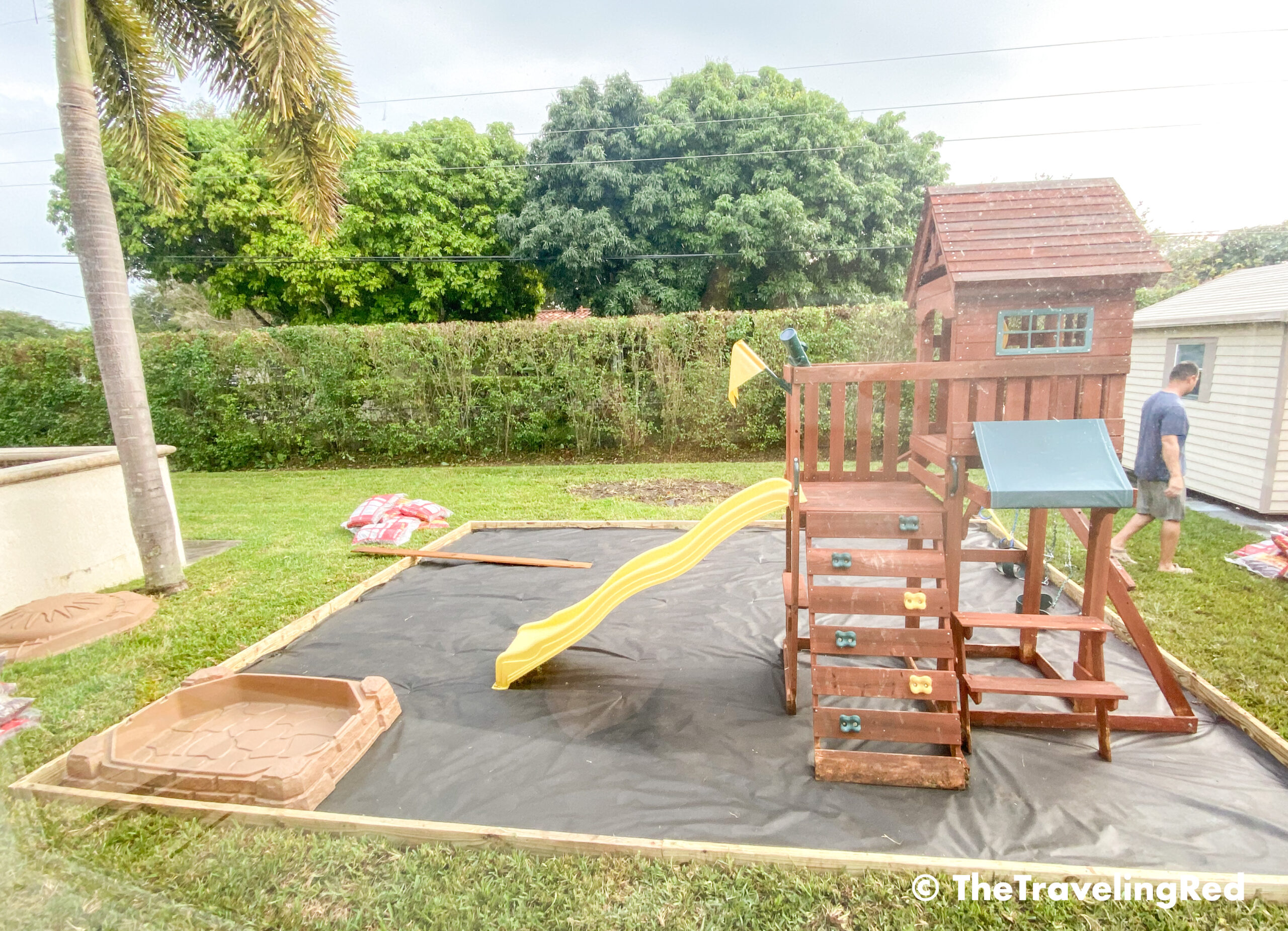 How to build a custom backyard playground with rubber mulch. Step 5 is to figure out the placement of the outdoor toys and adjust as needed. This space will fit our swingset, playhouse, sandbox or any other outdoor toys you plan to include. Perfect little outdoor play space for your kids to enjoy playing outside.