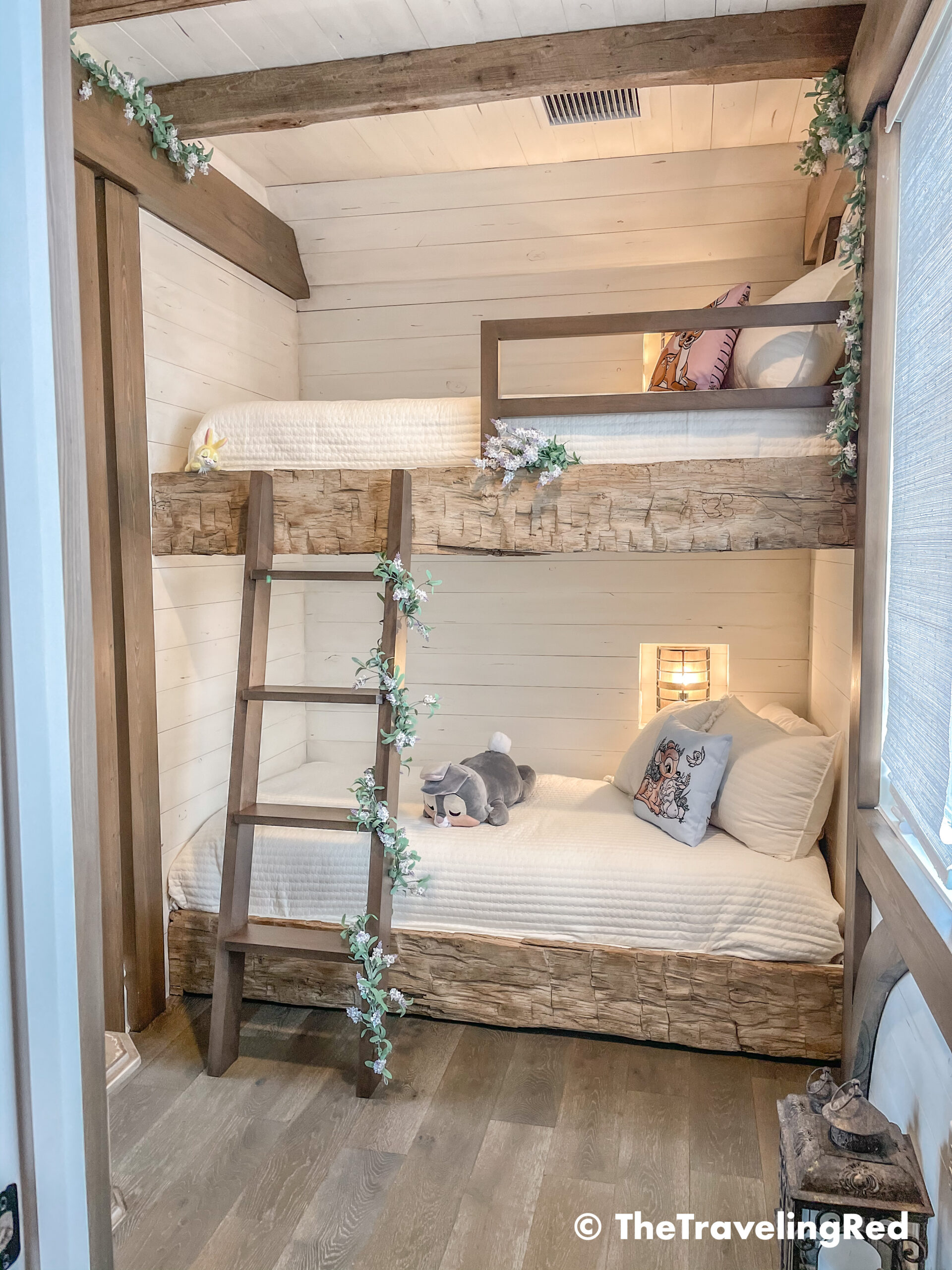 Bambi bunk bed room inside our Disney Golden Oak home. Inspiration for a tiny kids bedroom full of rustic charm and character. Reclaimed wood beams, shiplap, flowers and lanterns fill the room, along with Bambi details.