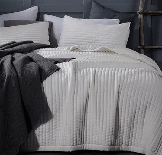 Clickable link to the perfect off white bedding for well under $100. It comes in all sizes and several colors. It includes the shams and has the best material. it is so comfortable and the perfect tone of white. No yellow tones or bright white, just that soft ivory.