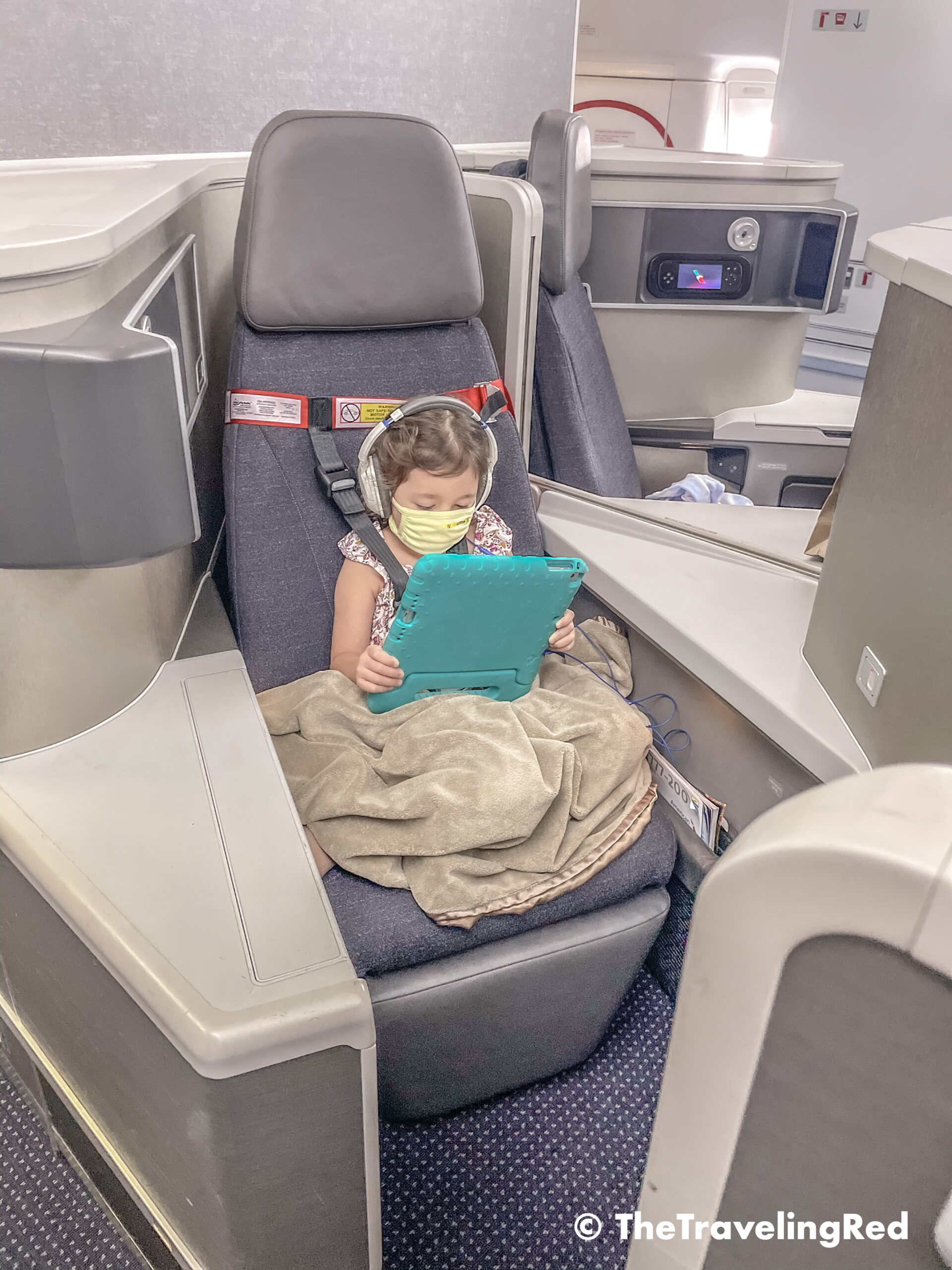 Travel hack for traveling with kids. FAA approved airplane harness as an alternative to installing a car seat on an airplane. It it small and fits in your purse. The harness works with the airplane lap belt to restrain similar to a car seat. It does not affect the person sitting behind you because it goes under their tray table.